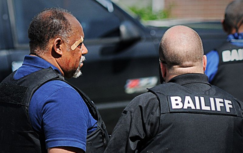 A bailiff was injured while attempting to serve an eviction notice at a Dayton house on Princeton Drive. (Marshall Gorby/Staff)