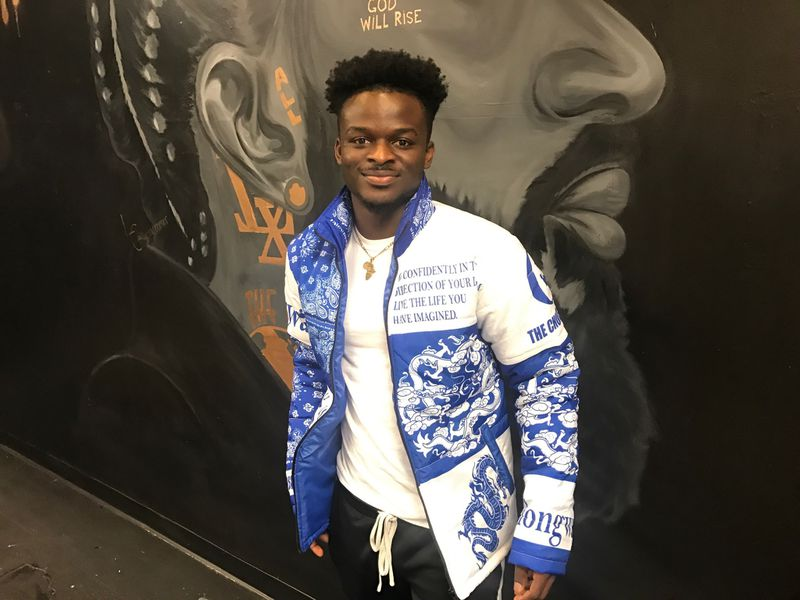 Herbert Chongwain models one of the winter jackets he's designed in his Chongwain collection. Tom Archdeacon/STAFF