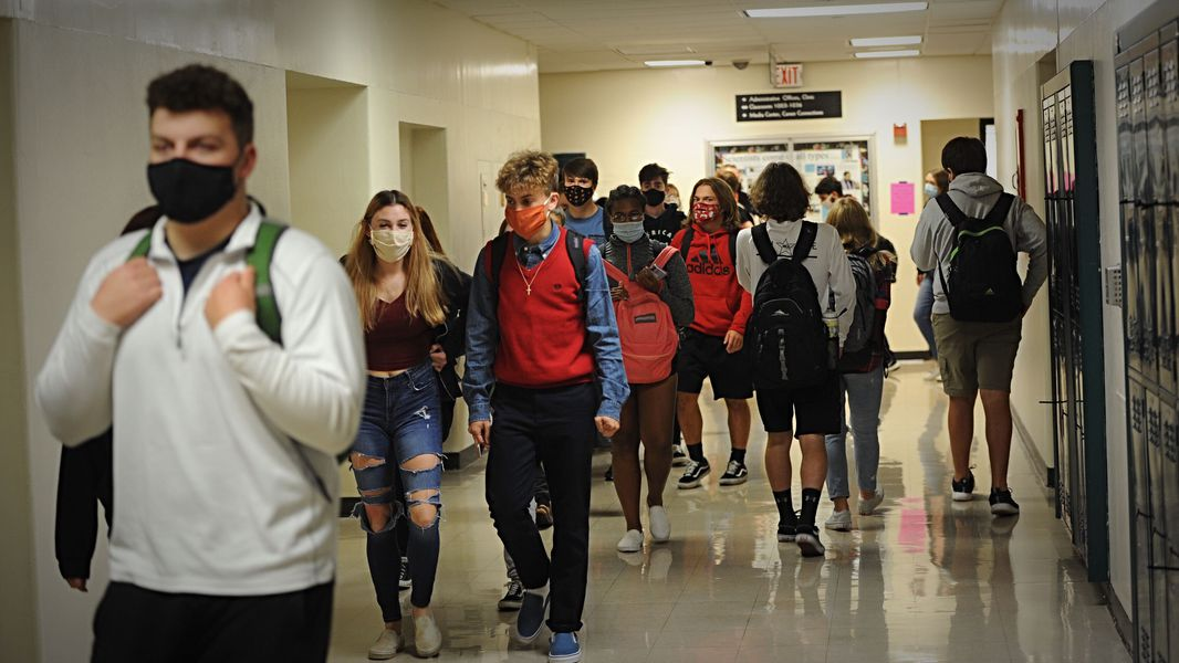Beavercreek High School students walk to their next classes during an October school day. BHS students are learning remotely this week, then hope to stair-step their way back -- hybrid the week of Jan. 11, and fully in-person the week of Jan. 19.