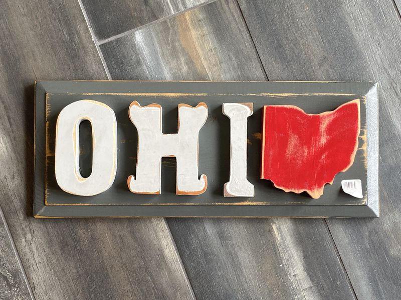 This Ohio wall hanging is among the items for sale from We Care Arts. CONTRIBUTED