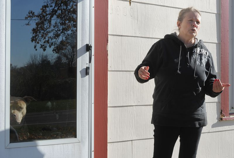 Sherry Edwards stand in front of her home in Butler Twp., Montgomery County, while discussing her options for testing her well for PFAS after the potentially deadly chemicals were discovered at nearby Aullwood Audubon Farm Discovery Center.  MARSHALL GORBYSTAFF