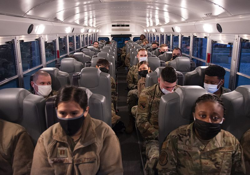 Airmen from the 88th Medical Group wait on a bus outside Wright-Patterson Medical Center on March 19 as they deploy to Detroit in support of the Federal Emergency Management Agency's COVID-19 response. According to the Federal Emergency Management Agency, military and support personnel throughout the country have already administered about 700,000 vaccines, and a single Type 1 team is capable of delivering 6,000. U.S. AIR FORCE PHOTO/WESLEY FARNSWORTH