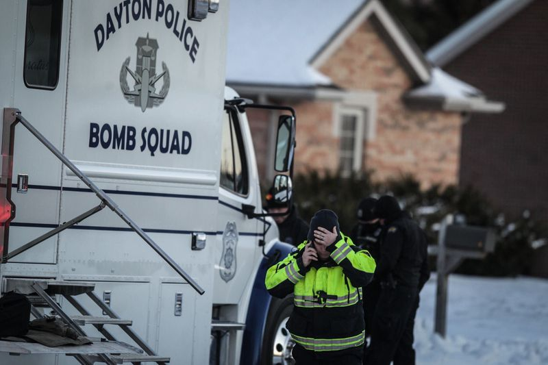 The Dayton Bomb Squad responded to an explosion followed by smoke seen Tuesday, Feb. 2, 2021, at a house in the 100 block of Warner Drive in Union.