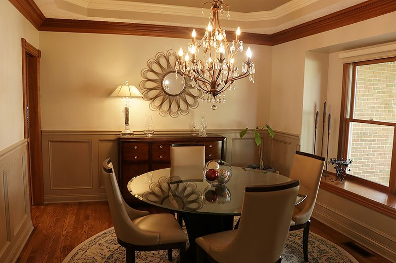 The dining room has wainscoting, a box window with a wood-capped sill and a tray ceiling with dentil crown molding. CONTRIBUTED PHOTO BY KATHY TYLER