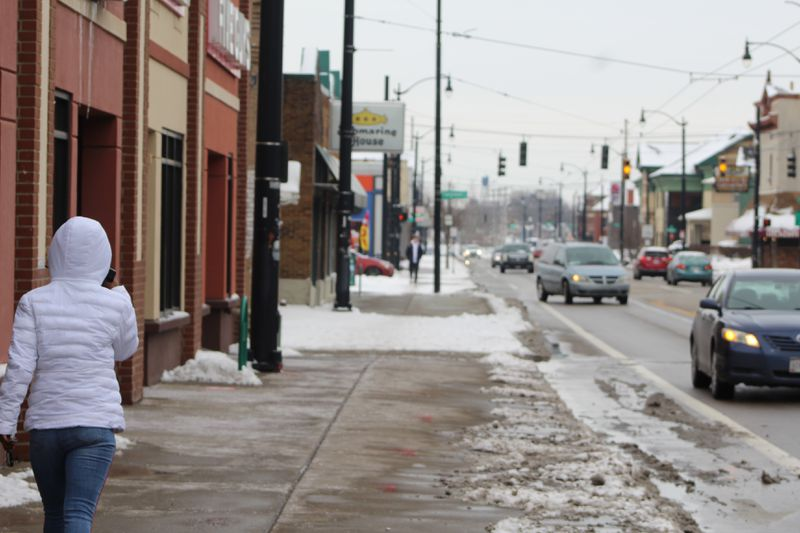 A young woman walked along Brown Street, which is home to several businesses that this year were approved for Paycheck Protection Program loans to help retain employees. CORNELIUS FROLIK / STAFF